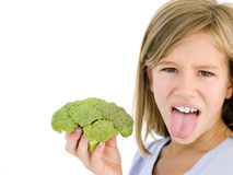 Young girl holding broccoli Stock Images