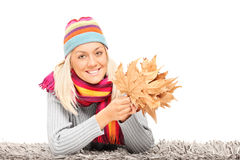 Young girl holding a bunch of dried leaves Stock Photo