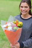 Young girl holding a bunch of flowers Royalty Free Stock Images