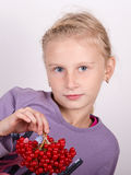 Young girl holding a bunch of viburnum Stock Image