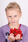 Young girl holding a bunch of viburnum Stock Photos