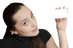 Young girl holding a business card Royalty Free Stock Images