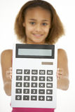 Young Girl Holding Calculator Stock Photography