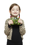 Young girl holding a camera smiling stock photo