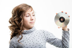 Young girl holding CD-ROM disk Royalty Free Stock Images