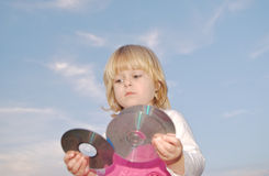 Young girl holding cd's Royalty Free Stock Photo