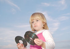 Young girl holding cd's Stock Photo