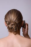 A young girl is holding a cell phone Royalty Free Stock Photography