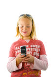 Young girl holding a cellphone Stock Images