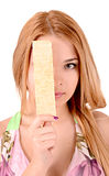 Young girl holding chips. Young girl holding a potato chips next to face stock photos
