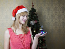 Young girl holding a christmas toy Stock Photo