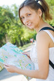 Young girl holding city map Royalty Free Stock Photography