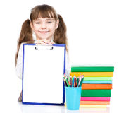 Young girl  holding clipboard with blank paper. isolated on white Stock Images