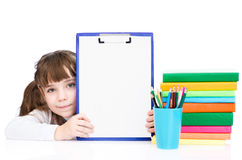 Young girl holding clipboard with blank paper. isolated on white stock photography