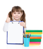 Young girl holding clipboard with an empty document and showing thumb up. isolated on white Royalty Free Stock Photo