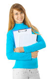 A young girl holding clipboard and notepad Royalty Free Stock Photo