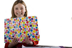 Young girl holding colorful folder, cut out Stock Photography