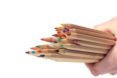 Young girl holding crayons. Young girl holding colorful pencils Royalty Free Stock Photography