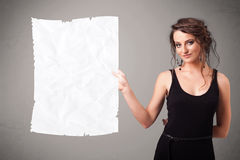 Young girl holding crumpled white paper copy space Royalty Free Stock Photography