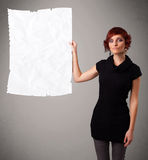 Young girl holding crumpled white paper copy space Royalty Free Stock Photo
