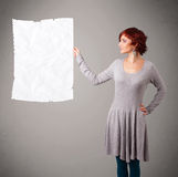 Young girl holding crumpled white paper copy space Stock Photo
