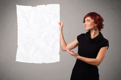 Young girl holding crumpled white paper copy space Royalty Free Stock Photos