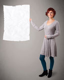 Young girl holding crumpled white paper copy space Royalty Free Stock Image