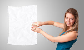 Young girl holding crumpled white paper copy space Stock Photography