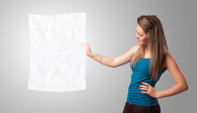 Young girl holding crumpled white paper copy space Stock Image