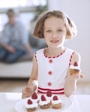 Young girl holding cup cake Royalty Free Stock Image