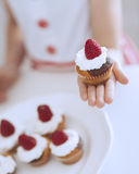 Young girl holding cup cake Royalty Free Stock Photos