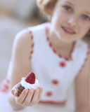 Young girl holding cup cake Stock Photography
