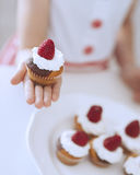 Young girl holding cup cake Royalty Free Stock Photography