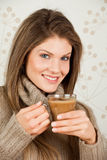 Young girl holding a cup of coffee and smi. Beauty, young girl holding a cup of coffee and smiling Stock Image