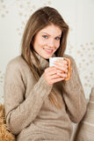 Young girl holding a cup and smiling Royalty Free Stock Image