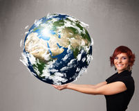 Young girl holding 3d planet earth Royalty Free Stock Photo