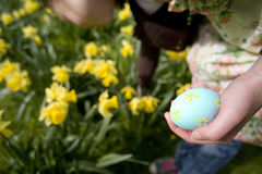 Young girl holding decorated Easter egg Royalty Free Stock Photography