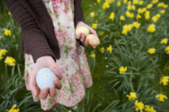 Young girl holding decorated Easter eggs Royalty Free Stock Image
