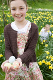 Young girl holding decorated Easter eggs Stock Photography