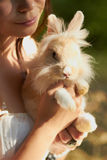 Young girl holding a decorative bunny Royalty Free Stock Photo
