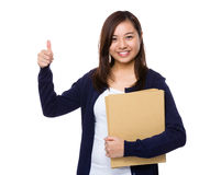 Young girl holding document work and thumb up gesture Royalty Free Stock Photography