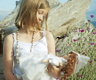 Young girl holding doll Royalty Free Stock Photo