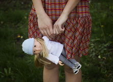 Young girl holding a doll. Stock Photos