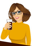 Young girl holding drink glass Royalty Free Stock Image