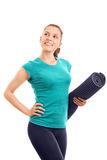 Young girl holding an exercise mat Royalty Free Stock Photo