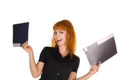 Young girl holding files. Young girl isolated on white background holding two files Stock Photos