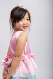 Young Girl Holding Flower, Rear View Stock Photo
