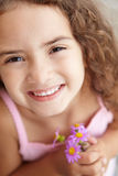 Young girl holding flowers Stock Photo