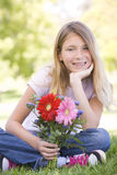 Young girl holding flowers Stock Images