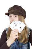 Young Girl Holding Four Aces In Front Of Her Face And Looking Into The Camera Against White Background Royalty Free Stock Photo